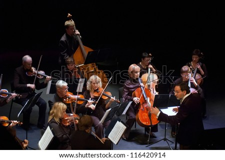 """DNEPROPETROVSK, UKRAINE-OCT. 22:""""Four seasons"""" Chamber Orchestra - main conductor Dmitry Logvin perform music of Christoph Willibald Ritter von Gluck on Oct. 22, 2012 in Dnepropetrovsk, Ukraine - stock photo"""