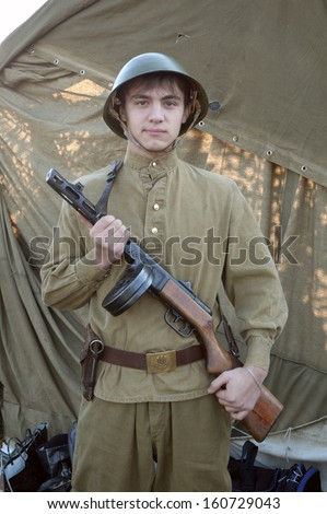 DNEPROPETROVSK, UKRAINE - OCTOBER 29: A member of Red Star history club wears historical Soviet uniform during historical reenactment of WWII on October 29, 2013 in Dnepropetrovsk, Ukraine