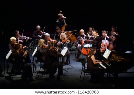 "DNEPROPETROVSK, UKRAINE - OCTOBER 22: ""Four seasons"" Chamber Orchestra - main conductor Dmitry Logvin perform music of Johann Sebastian Bach on October 22, 2012 in Dnepropetrovsk, Ukraine - stock photo"