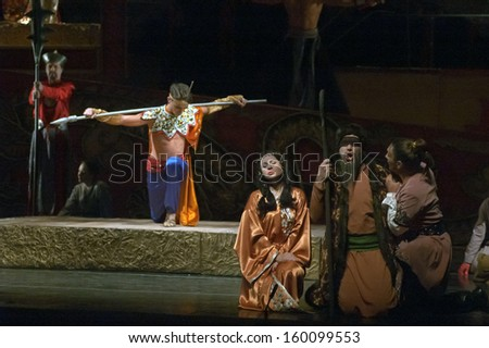 DNEPROPETROVSK, UKRAINE - OCTOBER 26: Members of the Dnepropetrovsk State Opera and Ballet Theatre perform Puccini's opera TURANDOT on October 26, 2013 in Dnepropetrovsk, Ukraine