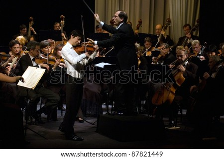 DNEPROPETROVSK, UKRAINE-OCTOBER 31: Violinist Daniel Milkis and Moscow Symphony Orchestra - main conductor Pavel Kogan performed music of Beethoven on October 31,2011 in Dnepropetrovsk, Ukraine