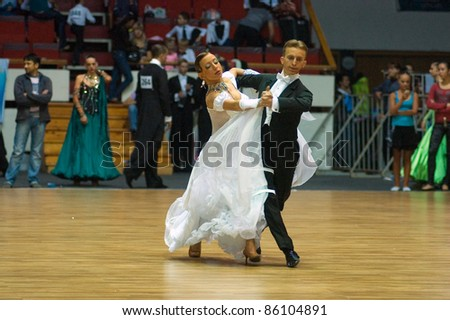 DNEPROPETROVSK, UKRAINE - SEPTEMBER 24: An unidentified dance couple in a dance pose during World Dance Competition DNEPR CUP 2011? on September 24, 2011 in Dnepropetrovsk, Ukraine.