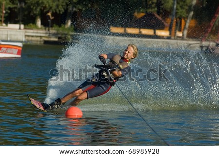 DNEPROPETROVSK, UKRAINE - SEPTEMBER 10: An unidentified participant shows her skills during  International Waterski and Wakeboard competition on September 10, 2010 in Dnepropetrovsk, Ukraine.