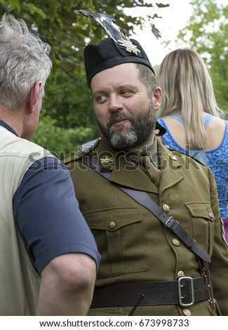 DNIPRO May 27th 2017. Portrait of a man in military uniform of a Scottish warrior. In a kilt, cap with a feather, close-up. Festival of Scottish Culture and Sports Highland Games
