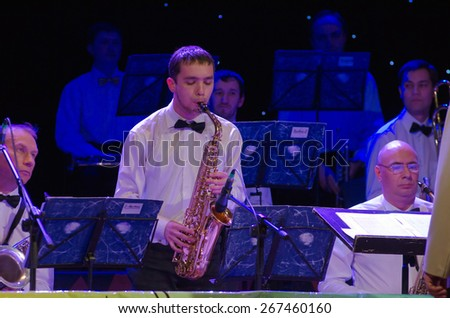 DNIPROPETROVSK, UKRAINE - APRIL 7: Members of the Philharmonic Society Jazz Orchestra perform on April 7, 2015 in Dnipropetrovsk, Ukraine - stock photo
