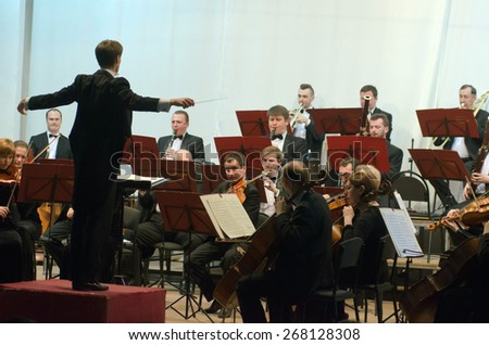 DNIPROPETROVSK, UKRAINE - APRIL 9: Members of the Symphonic Orchestra - main conductor Ivan Cherednichenko perform on April 9, 2015 in Dnipropetrovsk, Ukraine - stock photo