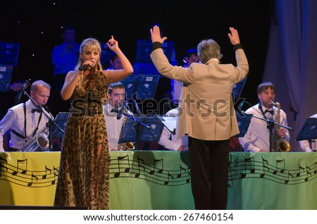 DNIPROPETROVSK, UKRAINE - APRIL 7: Singer Elena Ledovsky and members of the Philharmonic Society Jazz Orchestra perform on April 7, 2015 in Dnipropetrovsk, Ukraine - stock photo