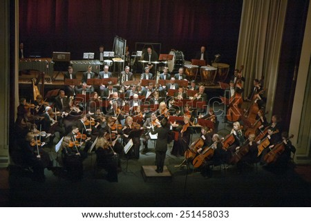 DNIPROPETROVSK, UKRAINE - FEBRUARY 9: Members of the Symphonic Orchestra - main conductor Natalia Ponomarchuk perform at the State Russian Drama Theatre on Feb. 9, 2015 in Dnipropetrovsk, Ukraine