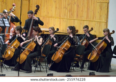 DNIPROPETROVSK, UKRAINE - FEBRUARY 23: Members of the Youth Symphony Orchestra FESTIVAL perform at the Conservatory on February 23, 2015 in Dnipropetrovsk, Ukraine