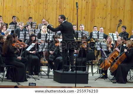 DNIPROPETROVSK, UKRAINE - FEBRUARY 23: Youth Symphony Orchestra FESTIVAL - main conductor Dmitry Logvin perform at the Conservatory on February 23, 2015 in Dnipropetrovsk, Ukraine - stock photo
