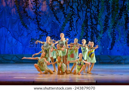 DNIPROPETROVSK, UKRAINE - JANUARY 11: Unidentified girls, ages 7-14 years old, perform Ballet pearls at State Opera and Ballet Theatre on January 11, 2015 in Dnipropetrovsk, Ukraine - stock photo