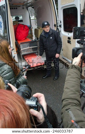 DNIPROPETROVSK, UKRAINE - JANUARY 20, 2015 : Volunteer Pavlo Khazan presents an ambulance acquired to assist the Ukrainian military in the zone of the antiterrorist operation.