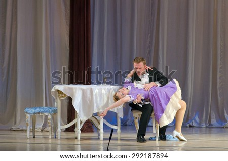 DNIPROPETROVSK, UKRAINE - JUNE 27, 2015:  Members of the Dnepropetrovsk State Opera and Ballet Theatre perform The Bat - stock photo