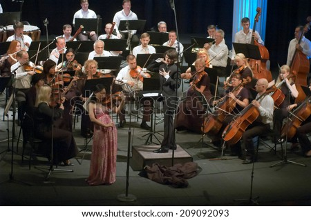 DNIPROPETROVSK, UKRAINE - JUNE 23: Members of the Symphonic Orchestra - main conductor Natalia Ponomarchuk perform at the State Russian Drama Theatre on June 23, 2014 in Dnipropetrovsk, Ukraine