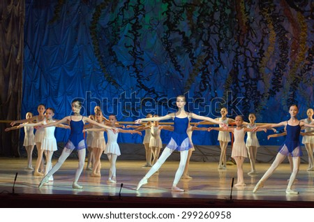 DNIPROPETROVSK, UKRAINE - JUNE 27, 2015: Unidentified girls, ages 7-15 years old, perform Children's Suite at State Opera and Ballet Theatre.  - stock photo