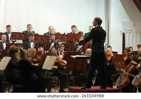 DNIPROPETROVSK, UKRAINE - MARCH 14: Members of the Symphonic Orchestra - main conductor Ivan Cherednichenko perform on March 14, 2015 in Dnipropetrovsk, Ukraine - stock photo