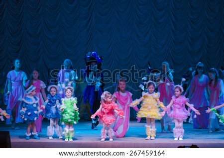 DNIPROPETROVSK, UKRAINE - MARCH 27: Unidentified children, ages 4-12 years old, perform PUSHISTIKI  on March 27, 2015 in Dnipropetrovsk, Ukraine - stock photo
