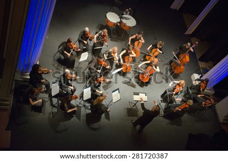DNIPROPETROVSK, UKRAINE - MAY 26: FOUR SEASONS Chamber Orchestra - main conductor Sergey Burko perform at the State Russian Drama Theatre on May 26, 2015 in Dnipropetrovsk, Ukraine