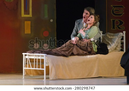 DNIPROPETROVSK, UKRAINE - MAY 21: Members of the Dnipropetrovsk State Opera and Ballet Theatre perform BOHEMIA on May 21, 2015 in Dnipropetrovsk, Ukraine