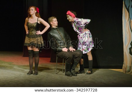DNIPROPETROVSK, UKRAINE - NOVEMBER 21, 2015: Members of the Dnipropetrovsk Youth Theatre VERIM perform DULCINEA TOBOSSKAYA. - stock photo