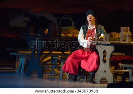 DNIPROPETROVSK, UKRAINE - NOVEMBER 29, 2015: Ukranian musical Sorochintsy Fair performed by members of the Dnipropetrovsk State Opera and Ballet Theatre.  - stock photo