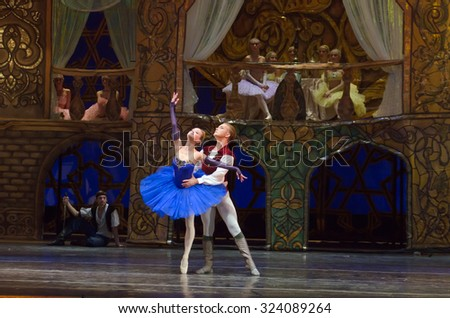 DNIPROPETROVSK, UKRAINE - OCTOBER 4, 2015: Dancers Elena Pechenyuk and Alexei Chorich - members of the Dnipropetrovsk State Opera and Ballet Theatre perform Corsair. - stock photo