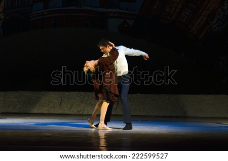 DNIPROPETROVSK, UKRAINE - OCTOBER 9: Members of the Dnepropetrovsk State Opera and Ballet Theatre perform FOXTROT 12 CHAIRS  on October 9, 2014 in Dnepropetrovsk, Ukraine.