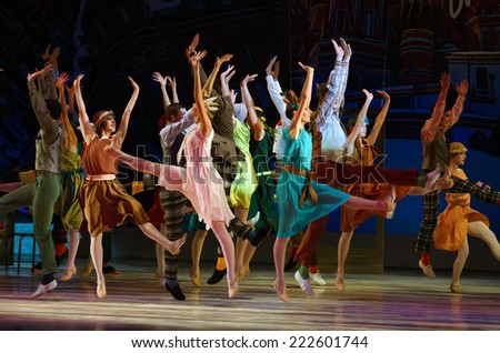DNIPROPETROVSK, UKRAINE - OCTOBER 9: Members of the Dnepropetrovsk State Opera and Ballet Theatre perform FOXTROT 12 CHAIRS  on October 9, 2014 in Dnepropetrovsk, Ukraine. - stock photo