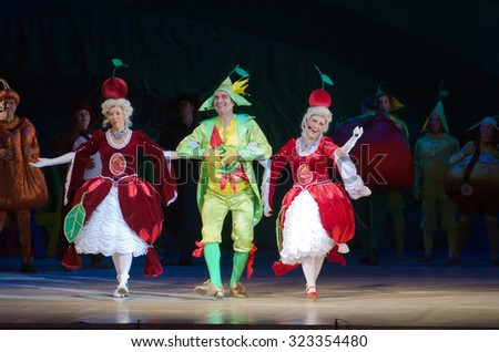 DNIPROPETROVSK, UKRAINE - OCTOBER 3, 2015: Members of the Dnipropetrovsk State Opera and Ballet Theatre perform CHIPOLLINO. - stock photo