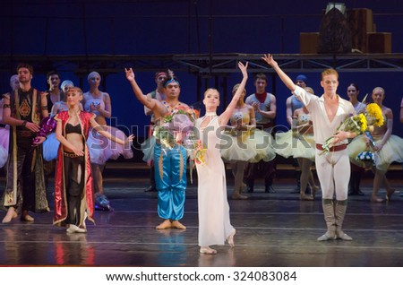DNIPROPETROVSK, UKRAINE - OCTOBER 4, 2015: Members of the Dnipropetrovsk State Opera and Ballet Theatre perform Corsair - stock photo