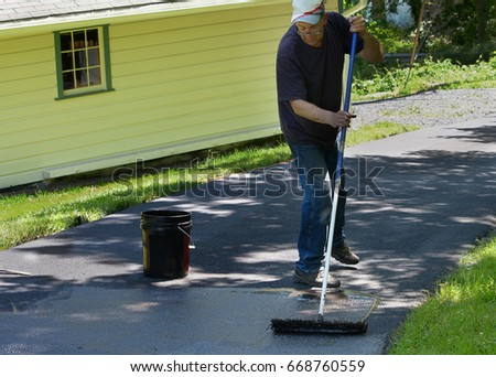 Do yourself home maintenance driveway resealing stock photo do it yourself home maintenance driveway resealing repair homeowner spreads blacktop sealant solutioingenieria Choice Image