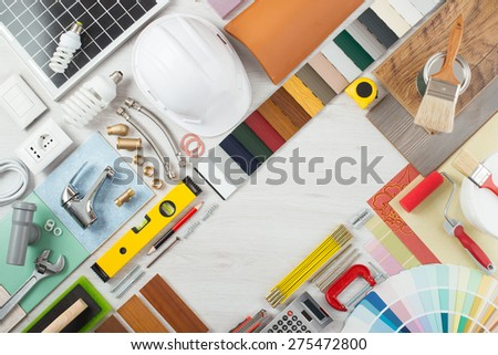 Do it yourself, home renovation and construction concept with DIY tools, hardware and swatches on wooden table, top view - stock photo