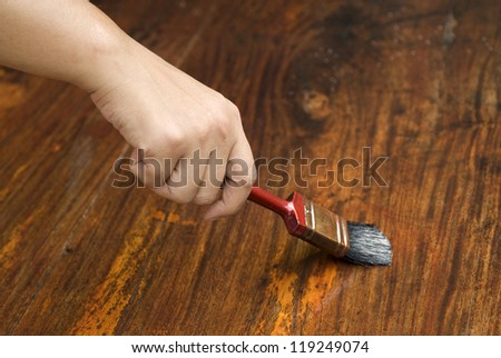 Do it yourself. Staining wooden table. - stock photo