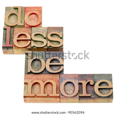 do less be more motivation - isolated text in vintage wood letterpress printing blocks