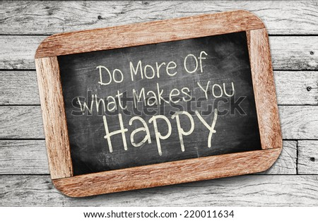 Do More Of What Makes You Happy Concept ,written on chalkboard. - stock photo