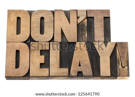 do not delay exclamation - procrastination concept  - isolated text in vintage letterpress wood type printing blocks - stock photo