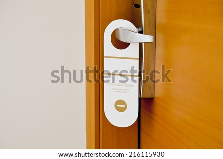 Do not disturb card on the door with free writable place on it - stock photo