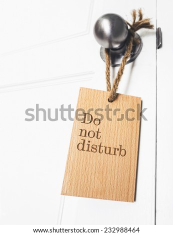 do not disturb sign hanging on the doorknob - stock photo