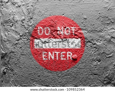 Do not enter road sign painted on grunge wall - stock photo