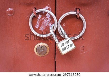 Do not enter, The master key is locked on wooden door - stock photo