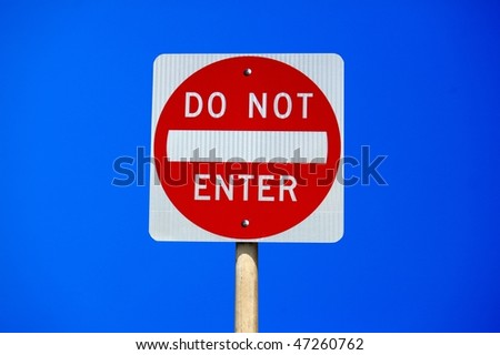 Do not enter traffic sign on clear blue sky - stock photo
