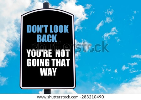 DO NOT LOOK BACK YOU ARE NOT GOING THAT WAY  motivational quote written on road sign isolated over clear blue sky background with available copy space. Concept  image