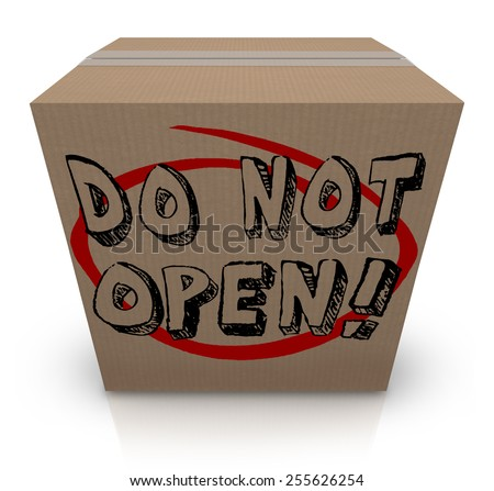 Do Not Open words on a cardboard box to illustrate a package or parcel that is secret, confidential, sensitive, classified, private, or a surprise gift or present forbidden to you - stock photo