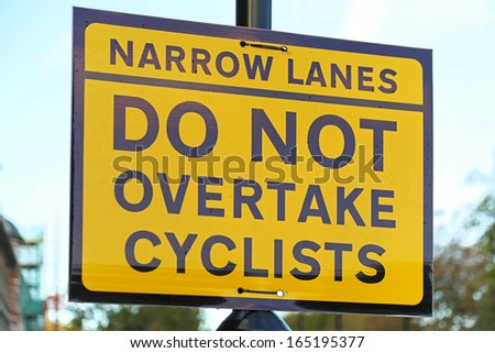 Do not overtake cyclist yellow traffic sign
