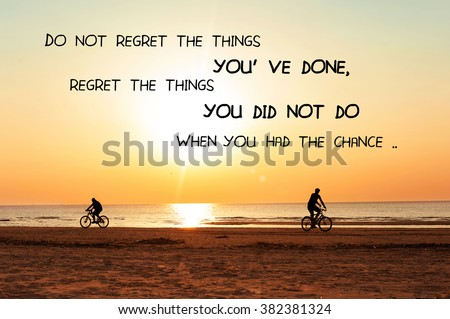 Do not regret the things you have done, regret the things you did not do when you had the chance. Inspirational motivation quote on sunset background. Vibrant multicolored outdoors horizontal image - stock photo