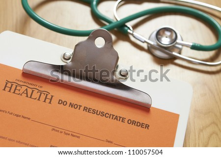 Do Not Resuscitate Order On Clipboard With Stethoscope - stock photo