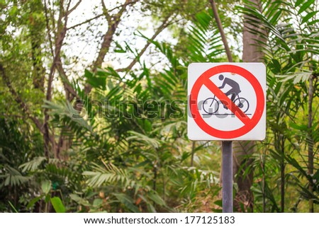 Do Not Ride Bicycle Sign in Garden.