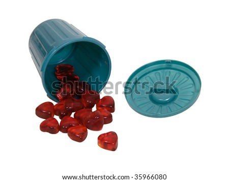 Do not throw away love shown by green plastic garbage container for rubbish and discarded items holding small glass hearts - path included