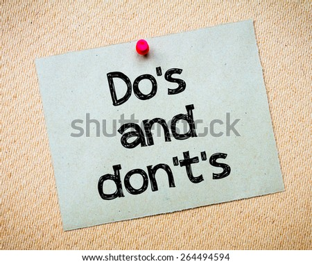 Do's and Don't's Message. Recycled paper note pinned on cork board. Concept Image - stock photo