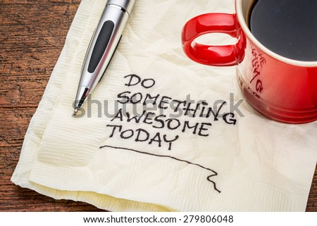 do something awesome today - handwriting on a napkin with a cup o - stock photo